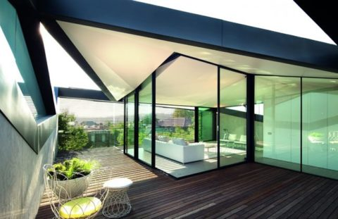 Modern house with geometrical sloped roof