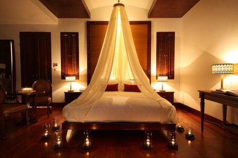 Romantic bedroom with candle