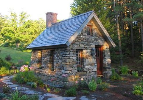 Small cottage with stone wall