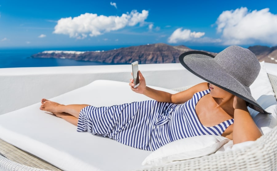 Woman on outdoor daybed