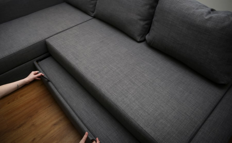 Person opening a sofa bed