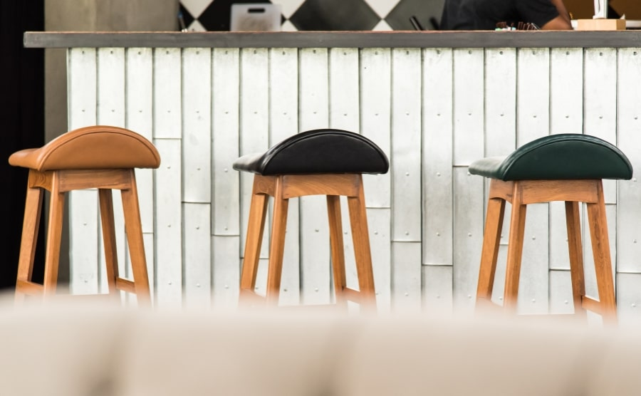 Three saddle stools in a row