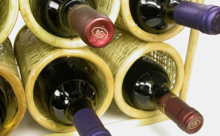 Wine rack with four wine bottles