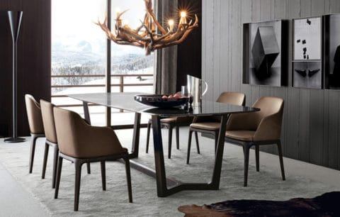 Contemporary dining room with unique lighting