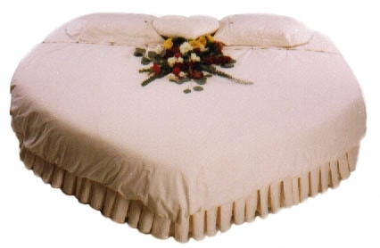 Heart shaped bed for wedding room