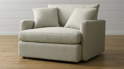 Creamy white chair and a half