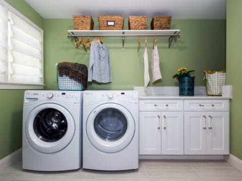 Laundry room with matching storage