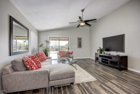 Contemporary living room with wooden floor