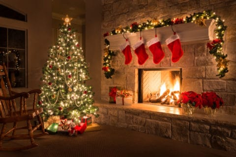 Christmas glowing fireplace, hearth, tree red stockings gifts and decorations