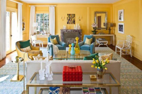 Yellow living room with colorful furniture