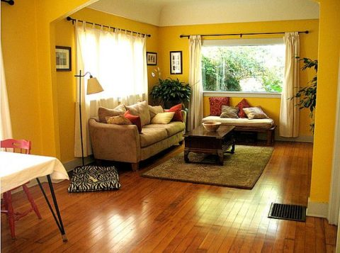Yellow living room with wooden floor