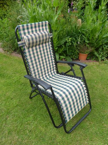 Black and white outdoor chairs and loungers