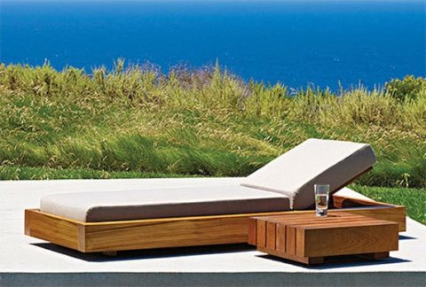 Wooden outdoor chairs and loungers