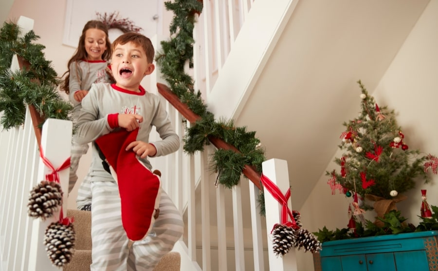 Children near Christmas decorations for stairs and landing