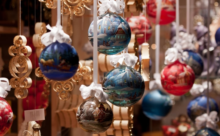 Christmas ornaments hanging from thread