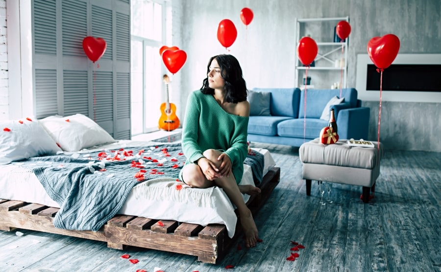 Woman in Valentine's Day decorated bedroom